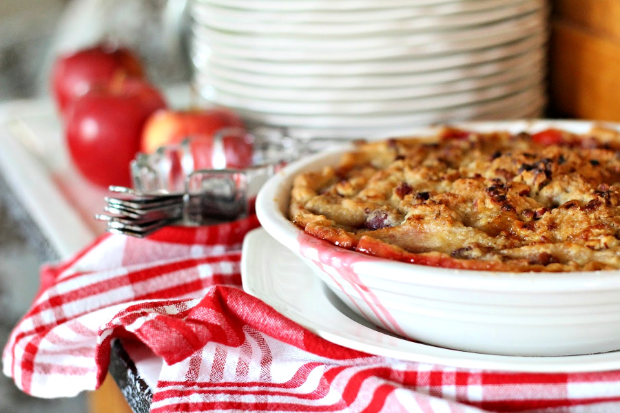 Easy recipe for cranberry apple pie with pecan streusel is an exciting combination of sweet and tart with a crunchy topping that's especially delicious served with a scoop of vanilla ice cream!