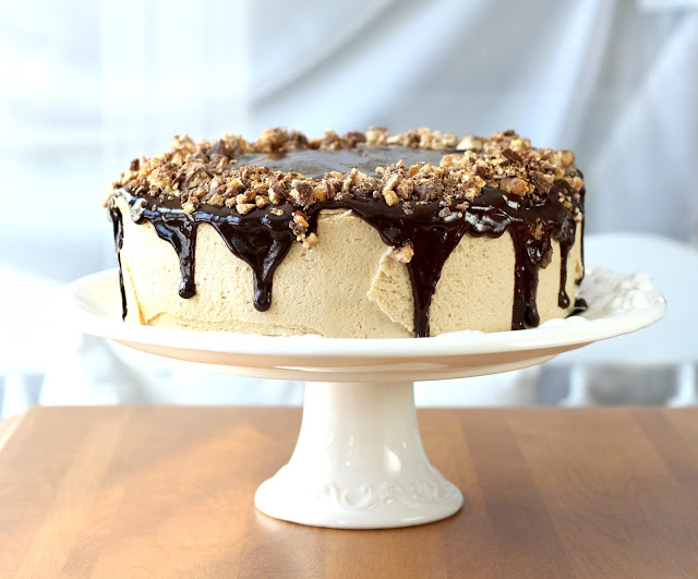Birthday time cake. Dark, chocolaty cake with peanut butter frosting, ganache drizzled on top and down the sides then sprinkled with chopped snickers bars.