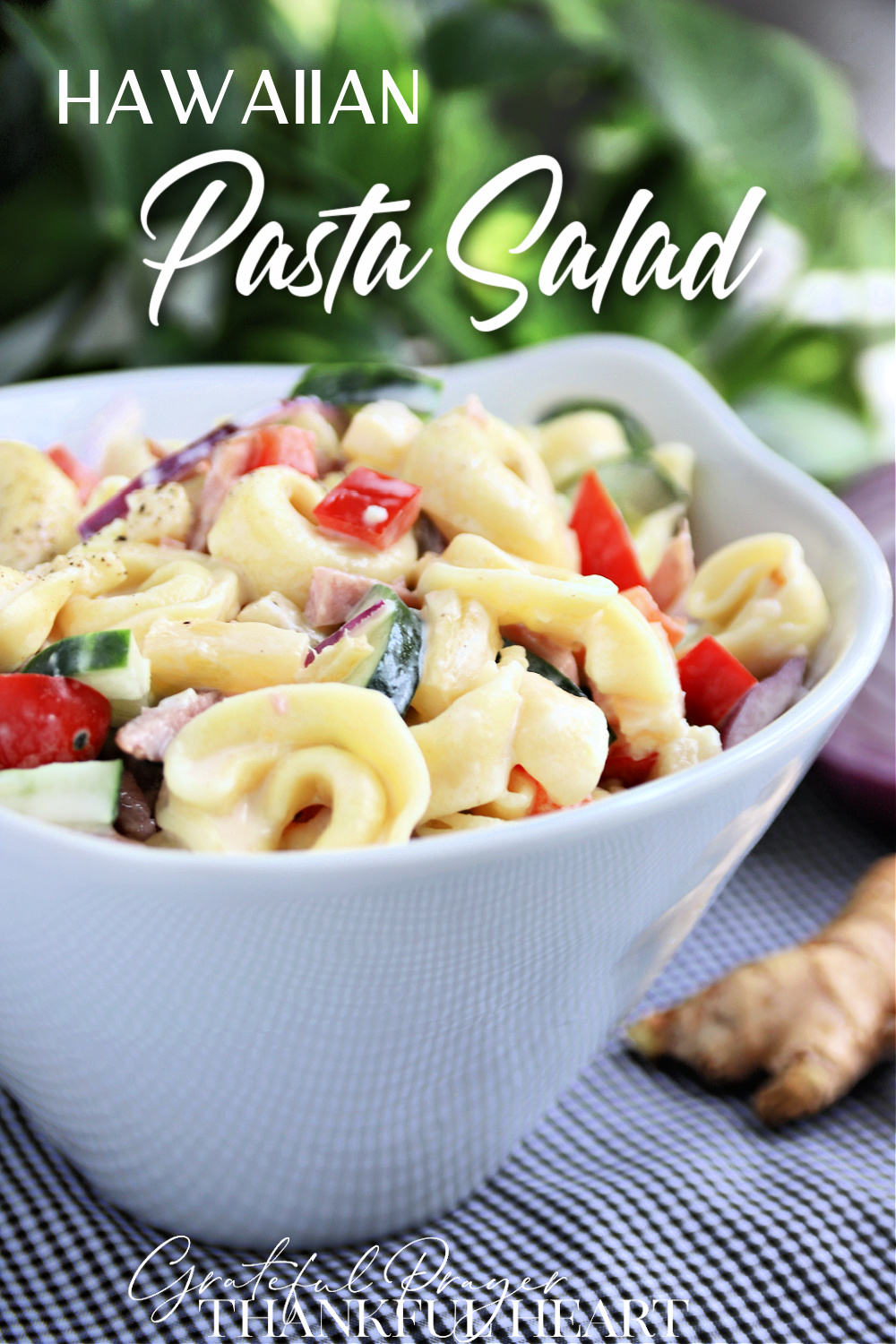 Hawaiian Pasta Salad with brightly colored veggies is a perfect summer salad. It is a hearty one too, with cheese tortellini, diced ham, bell peppers, cherry tomatoes and pineapple in a creamy dressing.