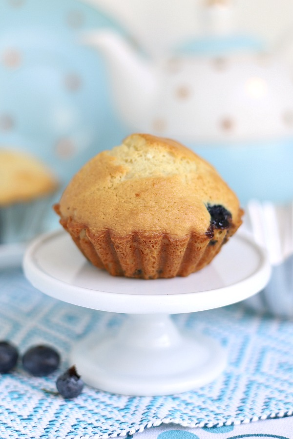 Easy blueberry muffins are made lighter by substituting applesauce for some of the butter for a yummy, cake-like breakfast or snack time treat.