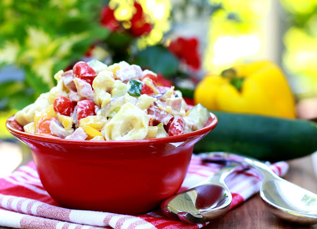 Hawaiian Pasta Salad, brightly colored with an abundance of crisp veggies is a perfect summer salad. It is a hearty one too, with the tortellini and diced ham. A great entree served with crusty bread (and maybe a glass of wine) for a lovely summer supper.