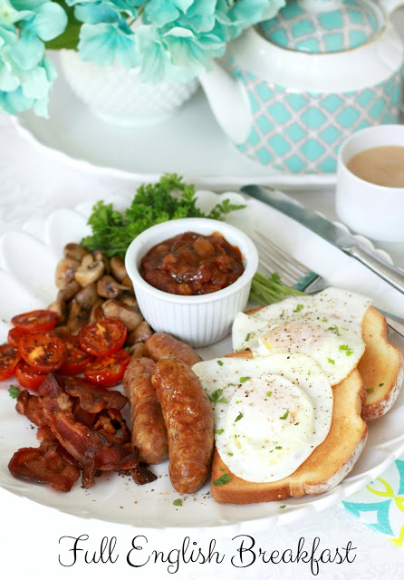 Full English Breakfast of sausage, bacon, eggs, toast, beans, tomato and mushrooms