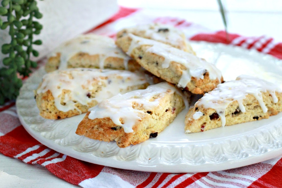 Easy recipe for anise cranberry orange scones are drizzled with glaze so perfect for breakfast, snacking. Package up a batch and surprise a friend or coworker with a thinking-of-you gift.