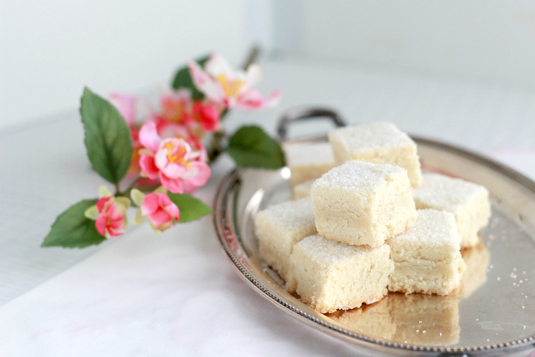 Call them biscuits or cookies, shortbread are delicious morsels of crumbly, buttery and delicate sweetness. Easy recipe for classic treats drizzled with or without lemon glaze.