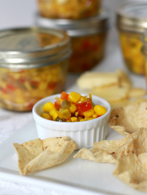A great salsa-like appetizer with chips or side for burgers and hotdogs, corn relish canning recipe is easy and tasty!