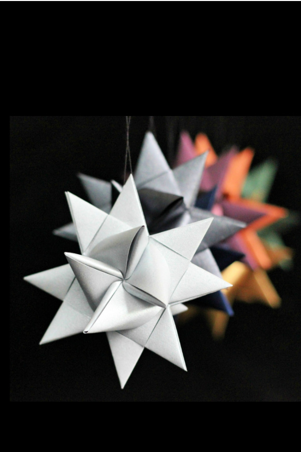 You can make folded paper German stars like you remember from your childhood! Follow this easy, step-by-step video tutorial with your kids or grandchildren. A fun craft DIY to make ornaments, decorate presents and for gift-giving.