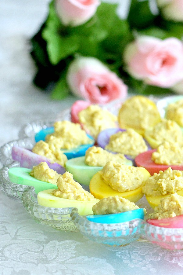 Bring springtime to your Easter table with a palate of soft pastel colored deviled eggs that are almost too pretty to eat. Instead of dying the egg shells, the cooked white part of the egg is colored then filled with the yolk mixture just like regular deviled eggs.