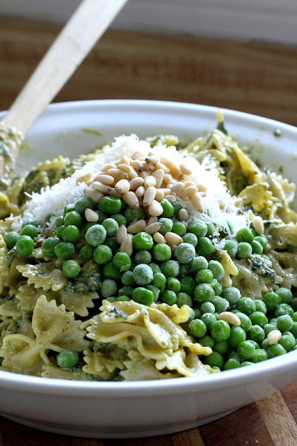 Pasta Pesto and Peas is full of summer flavors with garden-fresh ingredients like basil, garlic, sweet peas, and spinach. Great for patio parties, potluck dinners, a hearty lunch or dinner meal.