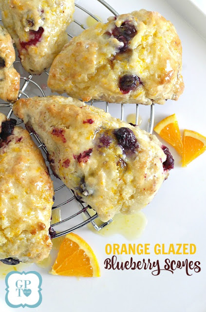 Delicious scones filled with blueberries with an orange or lemon glaze on top. Perfect for breakfast or at break time with your coffee or tea.