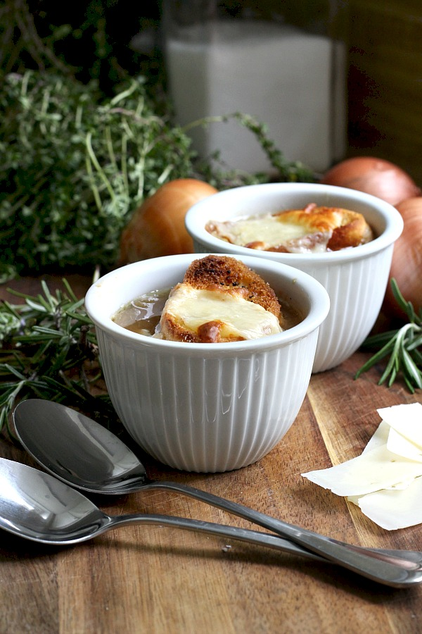 Easy recipe for French Onion soup in a rich beef broth with sweet caramelized onions and topped with toasted baguette and melty cheese.