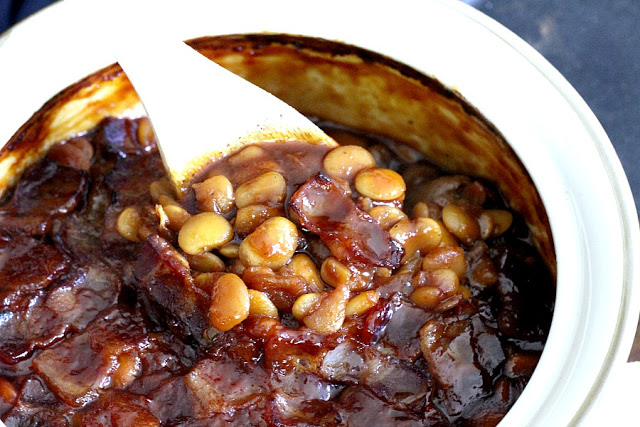 Homemade, old fashioned baked beans take a little time but so worth it! Tender navy or Lima beans in a brown sugar and molasses sauce is a perfect side.