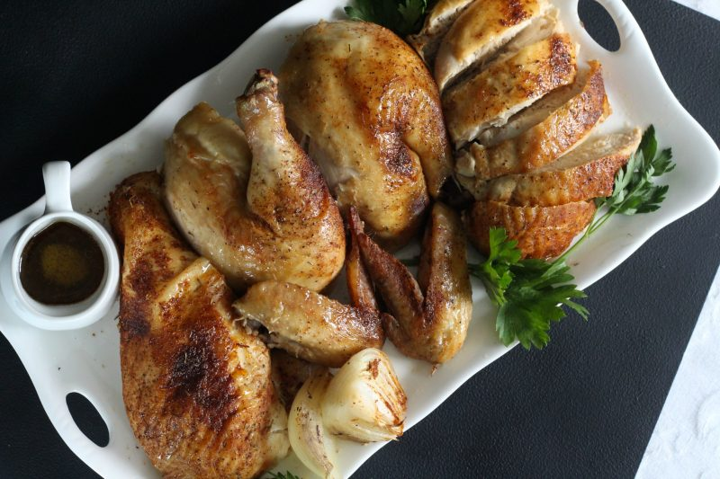 Easy recipe for moist and tender chicken, slow roasted in the oven with dry rub spices.