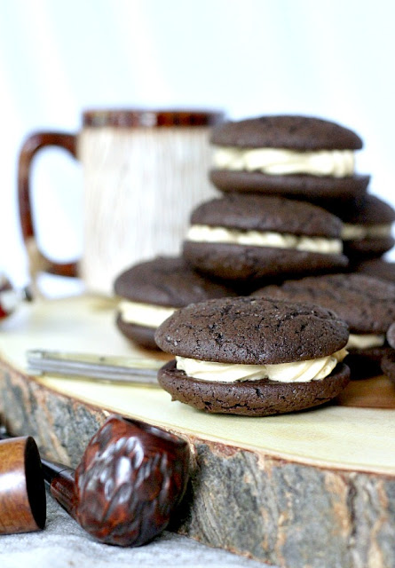 Chocolate Espresso Whoopie Pies are decadent and delicious. The dark chocolate cookie is rich and cake like. Or even brownie like, with a hint of coffee. Two cookies are sandwiched together with a frosting filling that is light and fluffy with more coffee flavor!