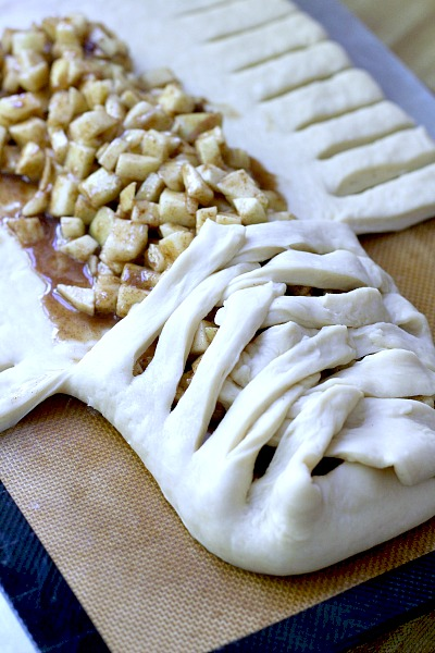 Frosted Apple Danish Braid made easy with dough from Bread Machine. Filled with cinnamon and apples and topped with frosting and toasted almonds. Breakfast or snack treat!