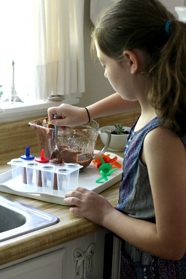 Enjoy an easy summertime recipe for homemade frozen chocolate peanut butter pudding pops for kids and adults alike.