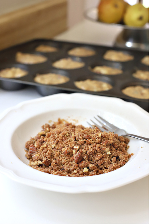 Making the crumb topping for pear, banana and walnut muffins.