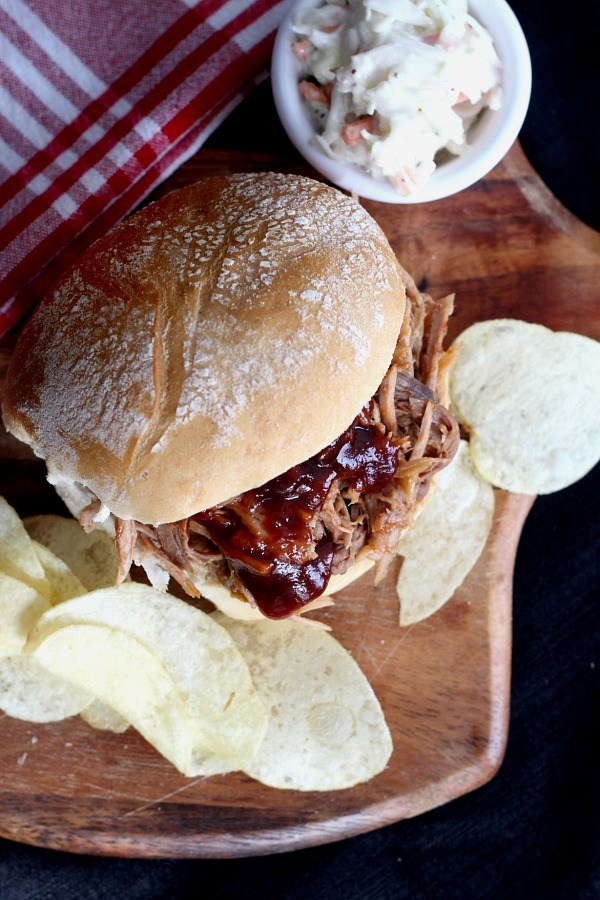 Roast an inexpensive pork shoulder in the oven slow and long for incredibly tender, delicious pulled pork. Pile on a roll with your favorite barbecue sauce for amazing pulled pork sandwiches!