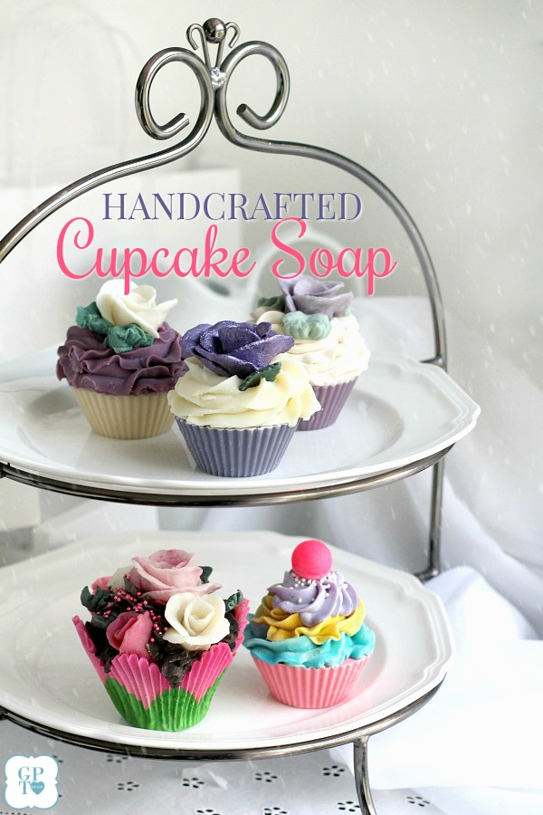 Handcrafted cupcake soap looks so real you might be tempted to take a bite. Scented with swirls of frosting and topped with cherries or pretty roses. They come gift-boxed, ready to give for the holidays to teachers, co-workers and friends. See how they are made and order link in post. Lovely in linen closet or to fragrance lingerie drawer. From Nancy's Garden Soap Co.