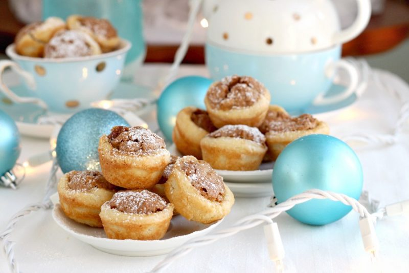These sweet little tartlets called Pecan Tassies are like having a bite-sized pecan pie. Sweet filling in a cream cheese, flaky cup, they are also known as Nut Lassies.
