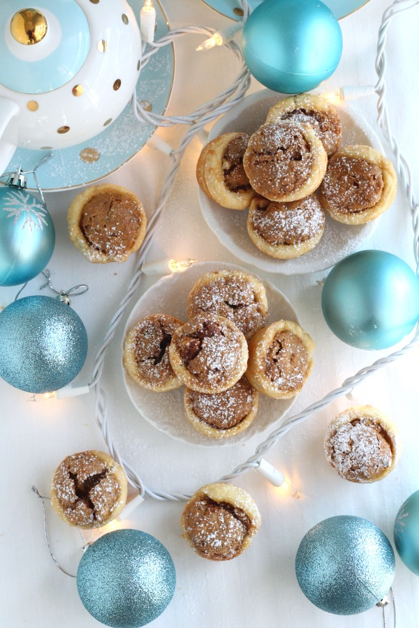 These sweet little tartlets called Pecan Tassies are like having a bite-sized pecan pie. Sweet filling in a cream cheese pastry cup, they are also known as Nut Lassies.