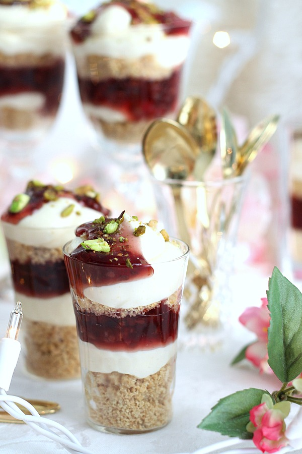 Easy No-Bake Raspberry and Pistachio Cheesecake Parfaits are so pretty and taste delicious. Make tiny, shot-size or fill you fanciest glasses. Change the fruit pie filling or use fresh fruit. It is up to you and it is all good!