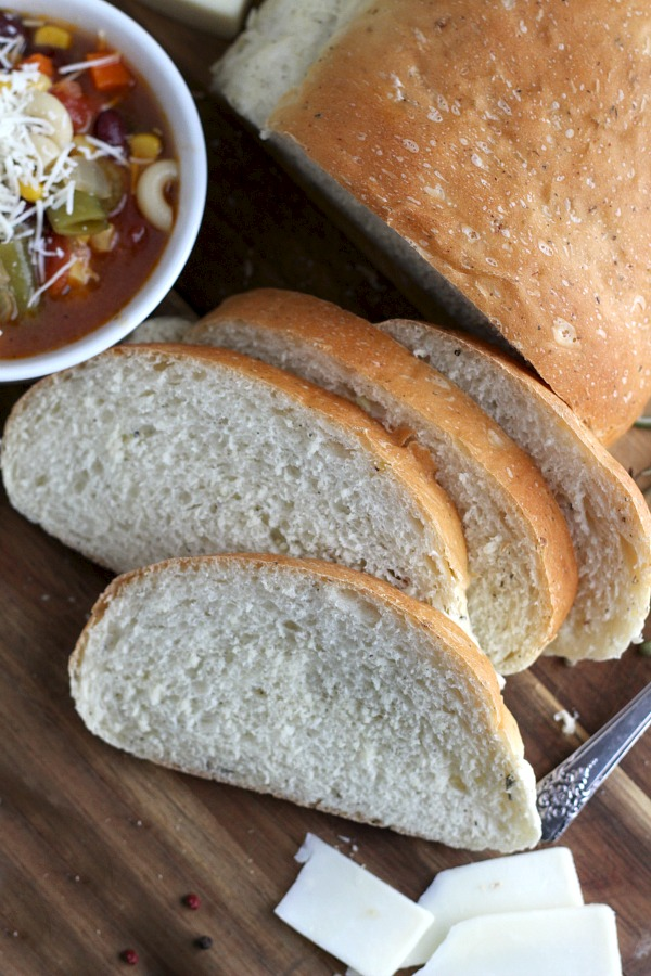 Cracked Pepper, Parmesan and Herbed Bread is full of flavor, slices beautifully and great for sandwiches or buttered and serves with soup or salad. Easy recipe dough is made in a bread maker and shaped as desired. Allow to rise, bake and enjoy!