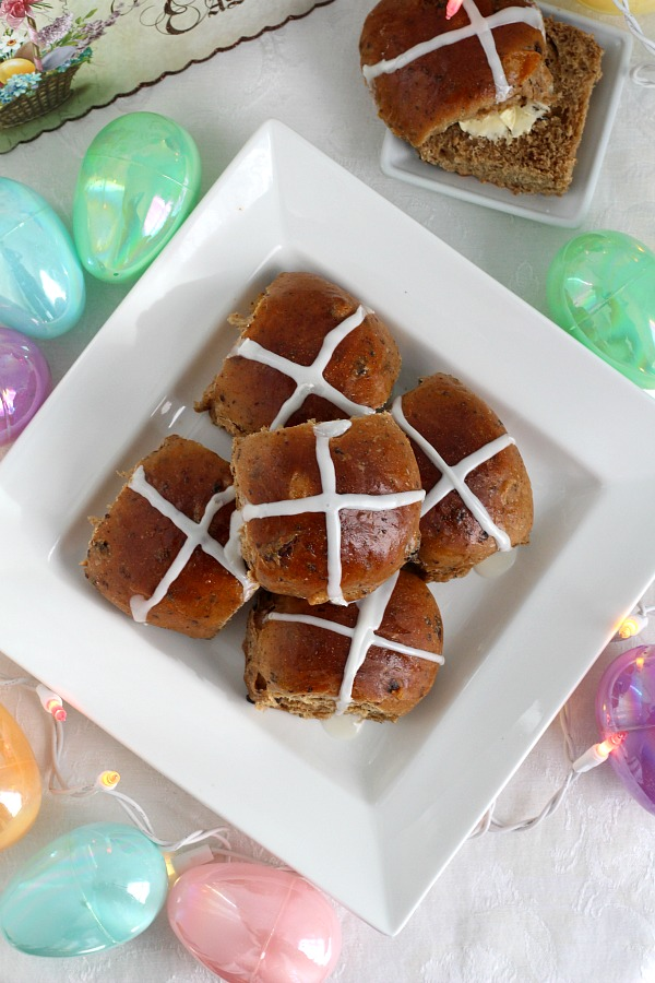 Hot Cross Buns are an Easter tradition and a lovely, sweet breakfast treat. Dough is made easily in a bread machine then shaped and baked in a dish. Frosting is piped on top in the shape of the cross. Perfect addition for brunch with hard-boiled, colored eggs.