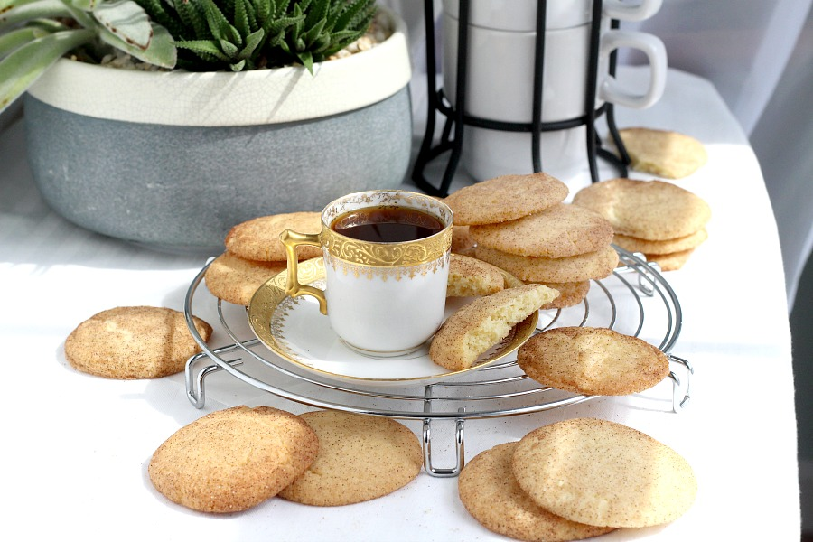Easy recipe for classic Snickerdoodles. Buttery cookies rolled in cinnamon sugar and baked until edges are crisp and centers are soft. Delicious served with coffee or as an after school treat for kids with glasses of cold milk.