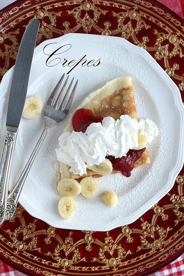 An easy, simple crepe, filled with a sweetened cream cheese mixture and dusted with confectioners' sugar is a classic. Spoon on fruit pie filling and a dollop of whipped cream to finish this lovely dessert.