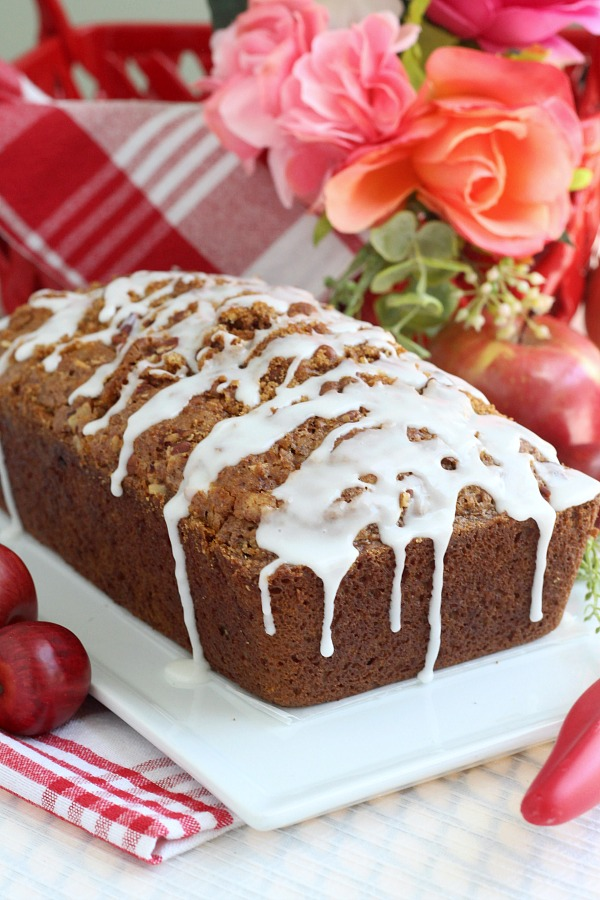 Easy recipe for frosted applesauce bread full of warm flavors of cinnamon, allspice & nutmeg. You don't even need a mixer to make this delicious quick bread