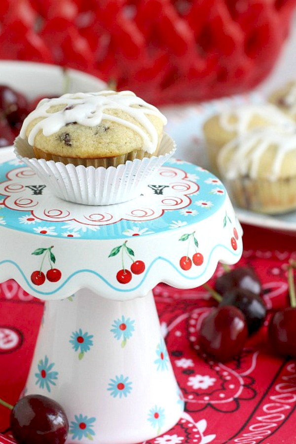 Lots of cherries and chocolate chips are folded into the batter of these delicious glazed Cherry Chocolate Chip Muffins for a delicious treat.