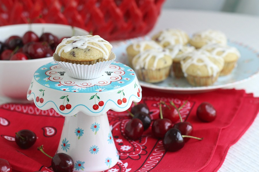 Both cherries and chocolate chips are folded into the batter of these delicious glazed Cherry Chocolate Chip Muffins. Perfect breakfast or snacking treat.