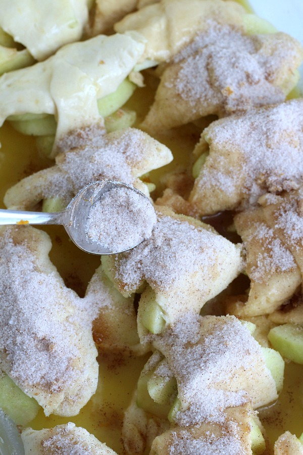 Super easy recipe for autumns favorite fruit, Apple Bundles are made with crescent rolls, cinnamon with a hint of orange. They smell heavenly and are perfect warm from the oven with a scoop of ice cream.