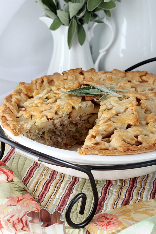 Pork and Apple Pie with sage is a delicious flavor combo of savory and a hint of sweetness in a flaky crust. Sliced apples are layered on top of a filling of seasoned ground pork making a lovely Sunday or weeknight dinner.