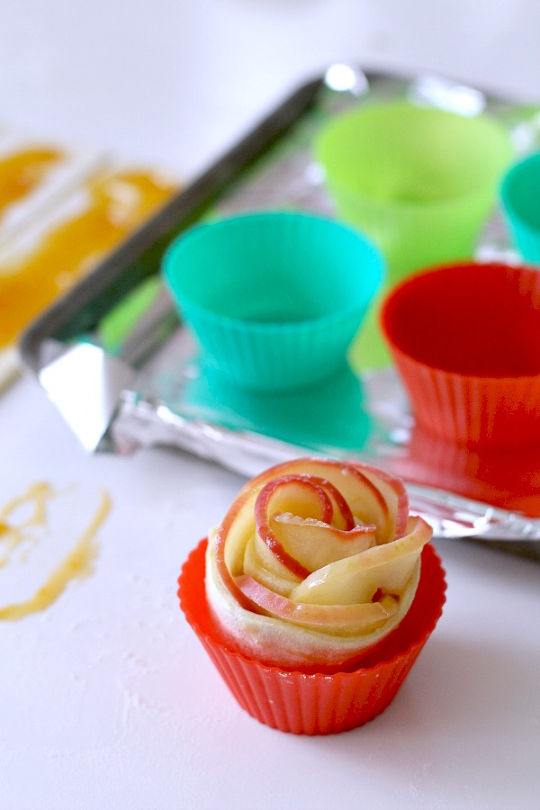 Rose Apple Pastries are pretty little bundles that taste like apple pie. Individual serving-size that look elegant and taste amazing but are an easy-to-make dessert using puff pastry sheets.