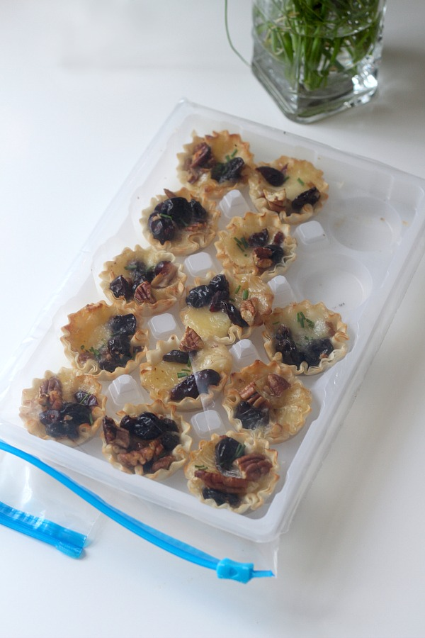 The holidays are a special time of entertaining and parties. Even a small get together with just a few friends is reason enough to set out some tasty tidbits. Brie tartlets with cranberries and cherries is a tasty appetizer that easy, quick and yummy!