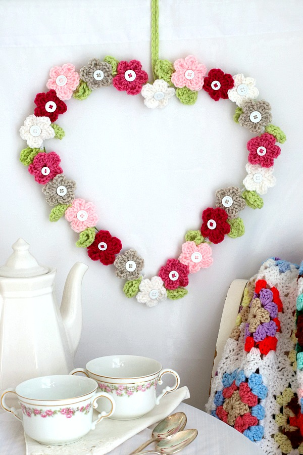 Quick, easy and perfectly pretty, this sweet crochet flower heart is cheerful, bright and a great craft for Valentine's Day. Easy pattern for heart & leaves.