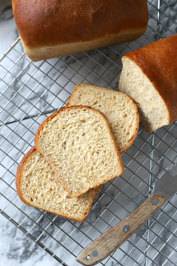 Easy recipe for delicious homemade honey whole wheat bread uses a bread machine to make the dough. Shape into loaves and bake. Perfect for slicing too.