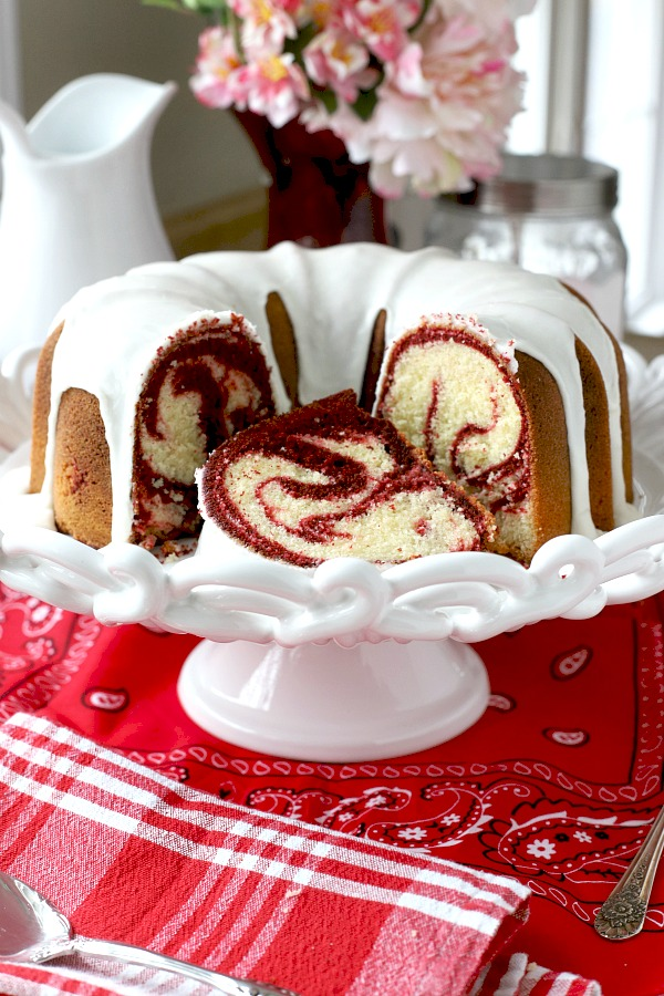 From scratch recipe for a moist red velvet marbled cake made in a Bundt pan has a lovely icing just right for Valentine's Day or celebrating a birthday.