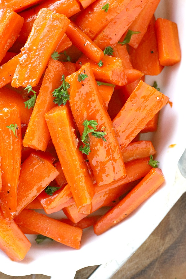 Colorful, elegant and delicious glazed carrots are quick and easy to make on the stove with just a few ingredients. A perfect & nutritious dinner side dish.