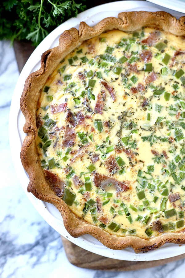 For breakfast, brunch or dinner, it doesn't get easier than classic quiche Lorraine. A creamy filling of Swiss cheese, veggies and bacon (or ham) bakes in a flaky crust. Just as perfect for entertaining as it is for a weeknight dinner.