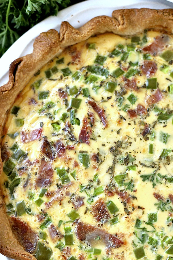 It doesn't get easier than classic quiche Lorraine for breakfast, brunch or dinner. A creamy filling of Swiss cheese, veggies and bacon (or ham) bakes in a flaky crust. Just as perfect for entertaining as it is for a weeknight dinner. Serve warm or at room temperature.