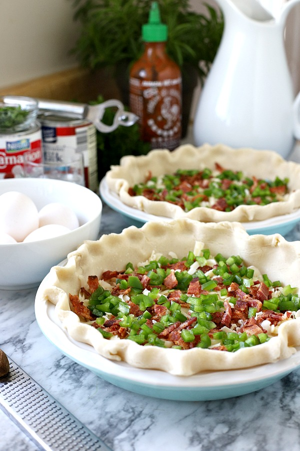 Prepping for a quiche Lorraine is quick and easy. Fill a crust with Swiss cheese, cooked bacon, a few veggies and pour in a milk and egg mixture. Pop in the oven and wait for a savory pie just as perfect for breakfast, brunch or dinner as it is for entertaining. A lovely Easter entrée!