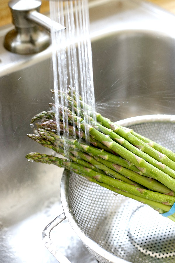 Fresh and delicious asparagus in a balsamic vinaigrette marinade is tender yet crunchy with a bright flavor from lemon zest. So easy to make with just a quick blanching. Pour on the salad dressing marinade and refrigerate until serving. A lovely Easter or brunch side dish.