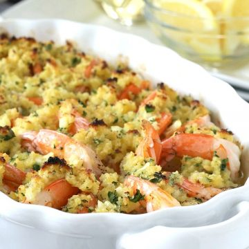 Elegant, delicious and so easy! Baked shrimp scampi is made by arranging shrimp in a dish and topping with a buttery herb mixture. Baked to hot and bubbly perfection. Try this easy recipe for your next dinner party.