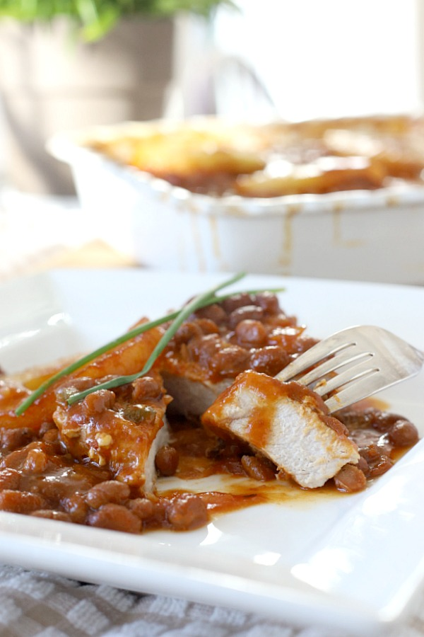 Easy recipe for Hawaiian pork chops and baked beans gets so much flavor from the addition of pineapple, brown sugar and molasses. Great weeknight dinner or potluck dish.