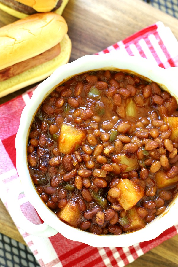 Hawaiian Baked Beans are sweet and delicious with chunks of pineapple, bell pepper and molasses for lots of flavor. Easy recipe can be made on the stove top or baked in the oven.