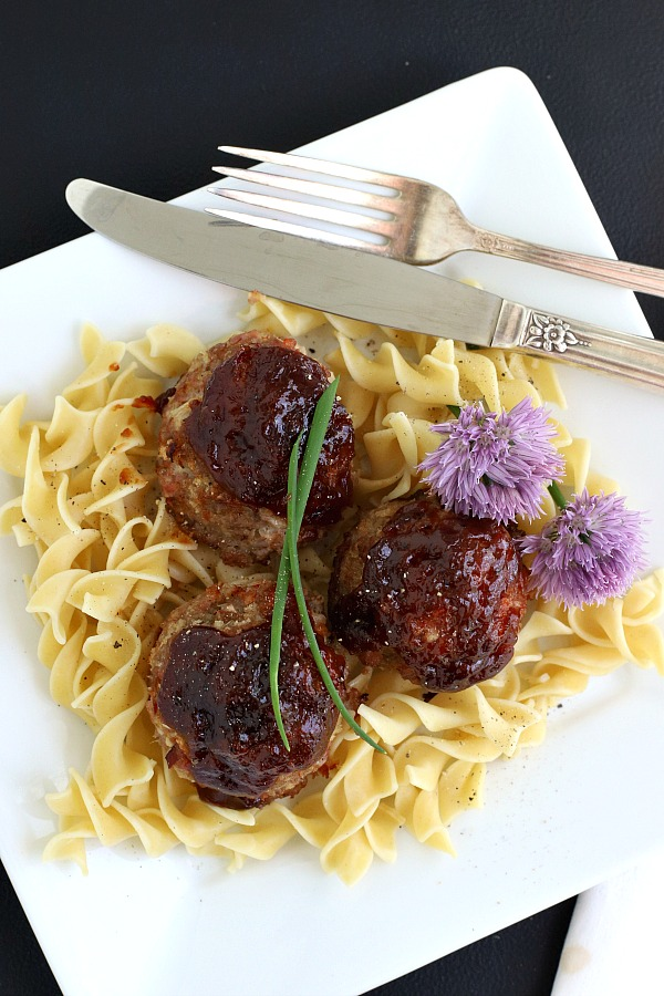 Baked ham balls are a great way to use leftover holiday ham for delicious combination of ham and ground beef topped with BBQ sauce. Serve the easy recipe with noodles, pasta or rice.