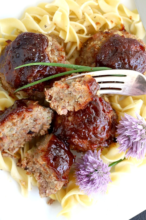 Easy recipe for baked ham balls using leftover ham and ground beef. Topped with barbecue sauce and baked for a flavorful weeknight dinner everyone will love.