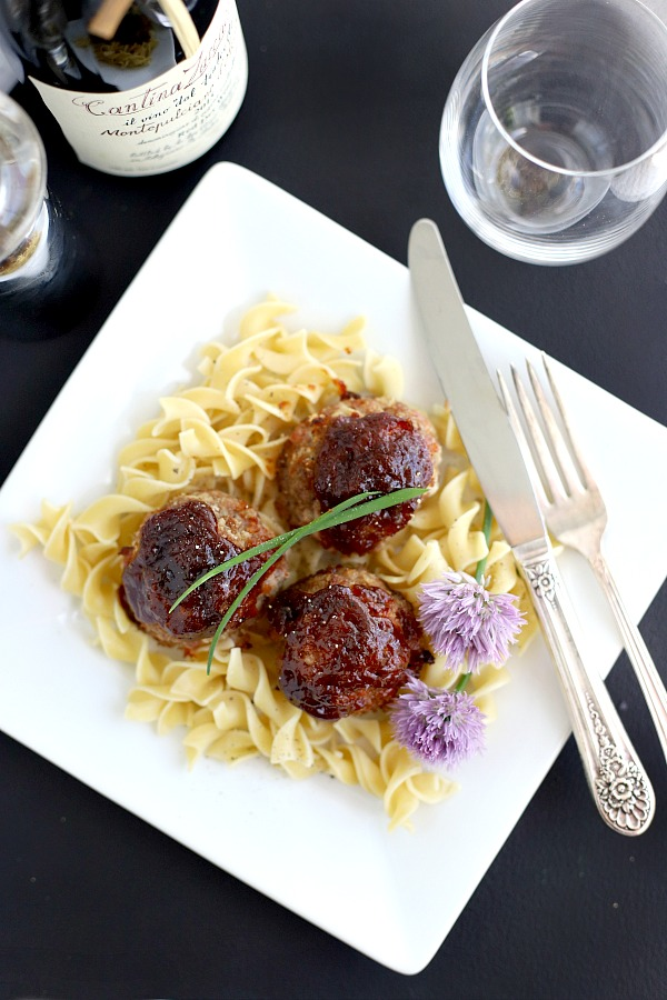 Delicious baked ham balls are a combo of leftover ham and ground beef. Topped with barbecue sauce, baked and served with noodles, pasta or rice for a great weeknight dinner.